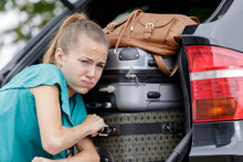 Struggling To Put Suitcases In A Car