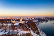 Panoramic View Of The Park In The City On The River Bank With Old Buildings At Sunrise In Winter Filmed From A Drone