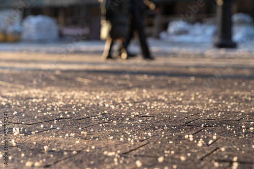 Canvas Print De-icing chemical reagent on the road will make the road safe in winter time