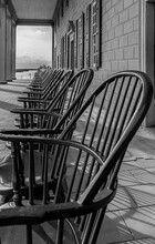 Perspective Photo Of A Line Of Vintage Rocking Chairs At George Washington Mount Vernon Historical Site In Virginia
