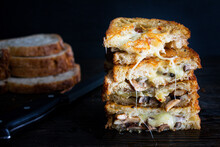 Garlic Mushroom Grilled Cheese Sandwiches: Two Sandwiches Made With Toasted Sourdough Bread And Filled With Melted Cheese And Mushrooms Sauteed With Garlic