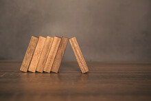 Close-up One Wooden Block Prevent Other The Wood Block From Falling Domino Concepts Of Financial Risk Management And Strategic Planning.