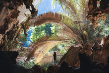 A Female Traveler Exploring Inside Hup Pa Tat Cave In Uthai Thani Province, Thailand