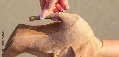 Fotografia, Obraz Broken stiletto heel on the shoes wearing by attractive young woman