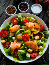 Salmon Salad - Smoked Salmon With Avocado And Mix Of  Vegetables On Wooden Table