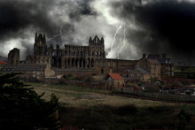 Whitby Abbey In North Yorkshire. UK. Coast. Bram Stoker Dracula Location. Sky Added For Effect.