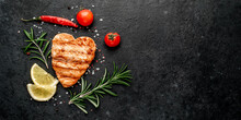 Grilled Salmon Steak With Spices In The Shape Of A Heart For Valentine's Day On A Stone Background With Place For Text