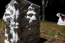 Bas-relief Of A White Lion At Night In The Light Of A Lantern. Garden Sculpture.