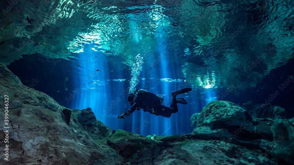 Fototapeta Cenote Tajma Ha with light rays Underwater in Yucatan, Mexico