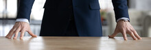 Horizontal Banner Close Up Confident Businessman Wearing Suit Standing At Wooden Office Desk, Employee Executive Boss Putting Hands On Table, Leadership And Professional Service Concept