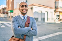 Young African American Businessman Smiling Happy Walking At The City.