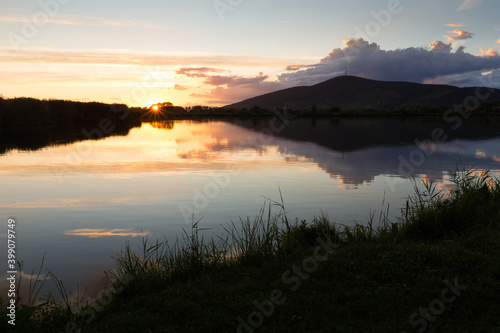 Photo Sunset over a fishpond