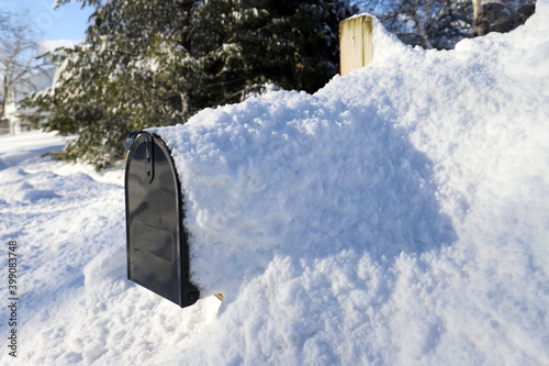 Photo Mailbox covered in snow after a blizzard