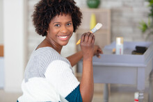 Attractive Woman Painting Furniture At Home