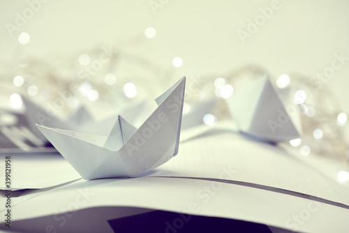 Foto paper boats on the documents