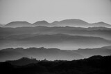 stratified fog between the hills four - 399126724