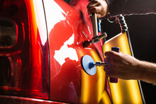 PDR. Professional Mechanic Removes Dents On The Car Body