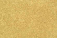 Gold Paper Texture. Smooth Matte Golden Foil Abstract Background. Close-up.