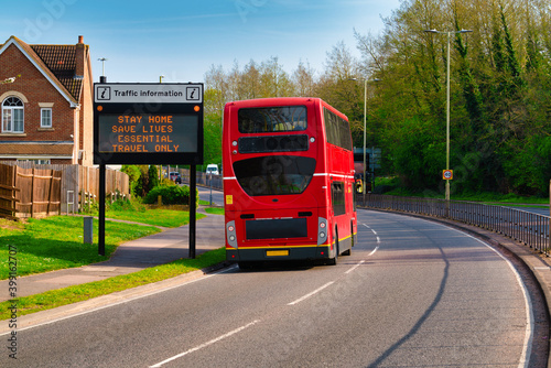 Fotografia Traffic information sign in England during Covid 19 pandemic with red double-dec