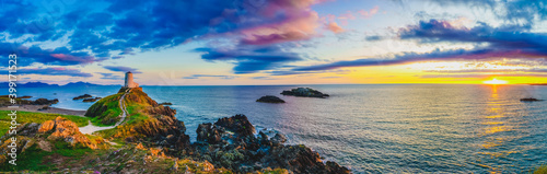 Fotografie, Obraz Sunset panorama of Lighthouse on Llanddwyn Island on the coast of Anglesey in No