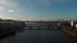 Dolly back falling drone shot over thames river Grosvenor Chelsea bridge London