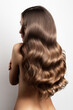 wavy blonde brown hair back view. Grey background
