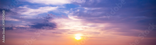 Fotografia World environment day concept: Sky and clouds autumn sunset background