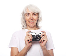 Senior Woman Photographer 60-65 Years Old With White Hair Standing, Holding Photocamera