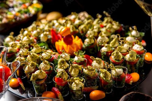 Tela Beautifully decorated catering banquet table with different food snacks and appe