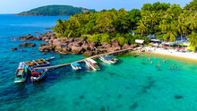 Aerial View Of Beautiful Landscape, Tourism Boats, And People Swimming On The Sea And Beach On May Rut Island (a Tranquil Island With Beautiful Beach) In Phu Quoc, Kien Giang, Vietnam.