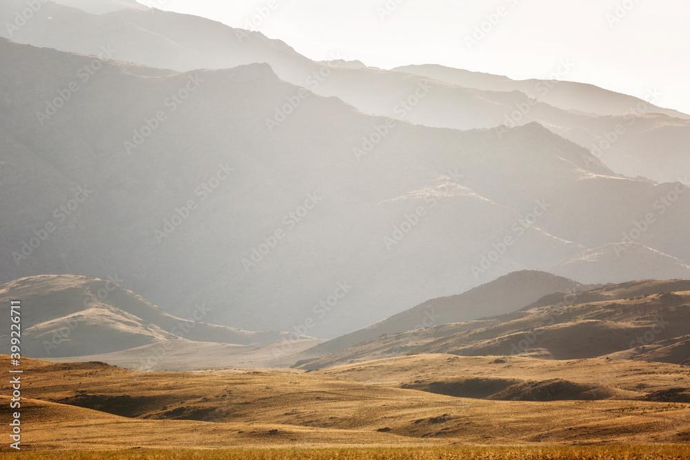 Fototapeta Mountain range at sunset, Uzbekistan