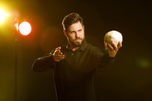 Male Actor With Human Skull On Stage