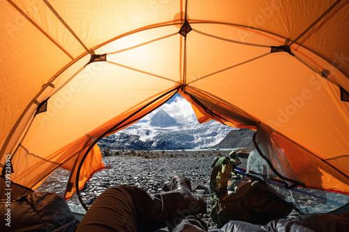 Obraz Hiker enjoy the beautiful landscape in tent - fototapety do salonu