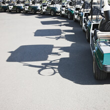 Golf Buggies Parked In A Crescent.