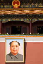 Exterior Of Chinese Building With Portrait Of Chairman Mao.