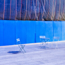 Folding Chairs In Front Of Construction Site Hoarding.