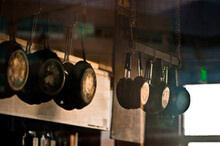 Pans Hanging In Commerical Kitchen.