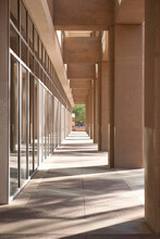 Colonnade Of Urban Office Building With Pillars.