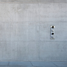 Metal Control Panel On Concrete Wall.