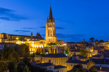 View Over St. Emilion Town Rooftops And Church At Dusk, Bordeaux Region.