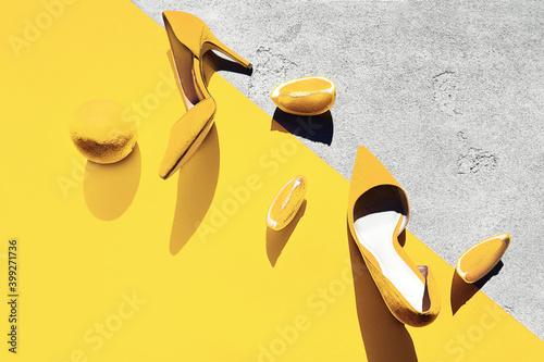 Fotografia, Obraz Bright illuminating yellow high heel shoes with lemon.