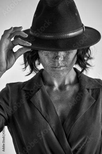 Fototapety, obrazy: elegant lady in dress and hat looking down posing, isolated on white studio background