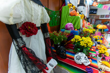 Dressed Skeleton Figure Used As A Symbol Of The Day Of The Dead During Celebration With Campasuchil Flowers And Paper Decoration And Sugar Skull