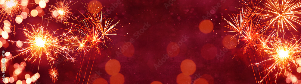 Fototapeta Silvester background panorama banner long - Firework on red texture with bokeh Lights and space for text