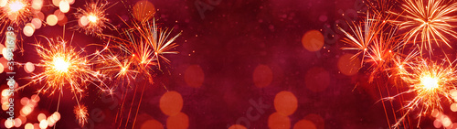 Fototapeta Silvester background panorama banner long - Firework on red texture with bokeh Lights and space for text obraz