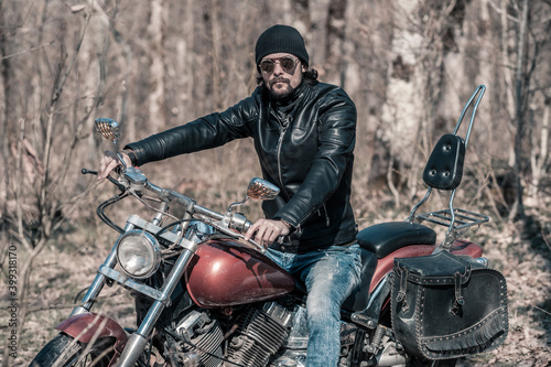 Foto Biker portrait. Photo with a motorcycle