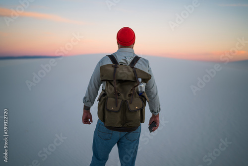 Fotografija Anonymous male tourist standing in arid valley