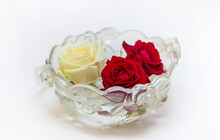 One White And Two Red Roses In A Glass Vase On A White Background