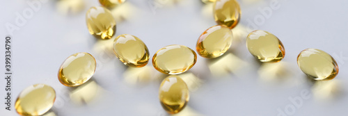 Canvas Print Shiny fish oil nutrition, omega 3,6,9 for good health lie in the shape of the sun closeup