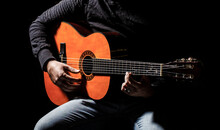 Guitarist Plays. Play The Guitar. Hipster Man Sitting In A Pub. Live Music. Guitars And Strings. Man Playing Guitar, Holding An Acoustic Guitar In His Hands. Music Concept